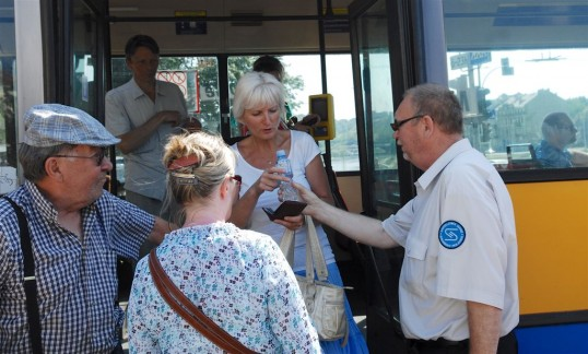 Bus Riders Get Drinks of Cold Water During Heat Wave in Vilnius